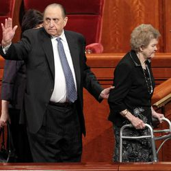 President Monson waves as he and his wife, Frances (right), leave the first session of the 181st Annual General Conference on Saturday, April 2, 2011, in the Conference Center.