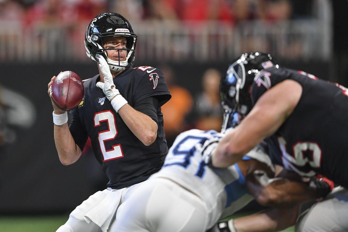 Atlanta Falcons quarterback Matt Ryan looks downfield against the Tennessee Titans during the first quarter at Mercedes-Benz Stadium.