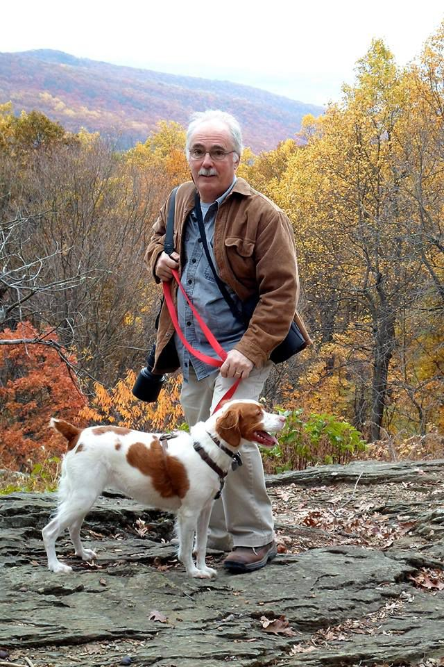 In addition to covering politics, journalist Mark Silva enjoyed being surrounded by and photographing nature. Here, he walks with his beloved Brittany dog, Kaya.   Facebook