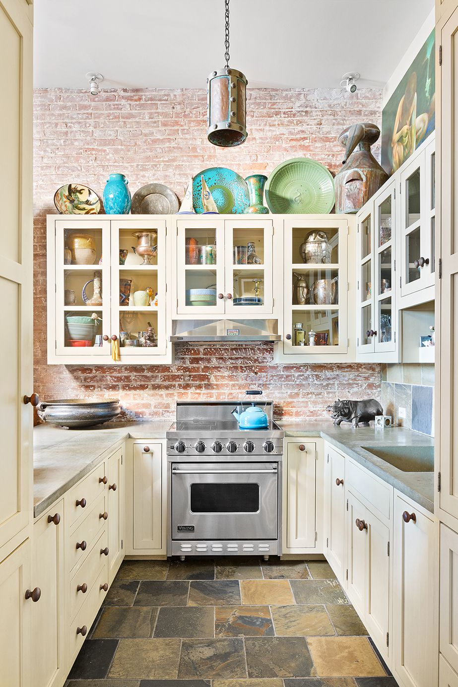 A kitchen with beige wood cabinetry.