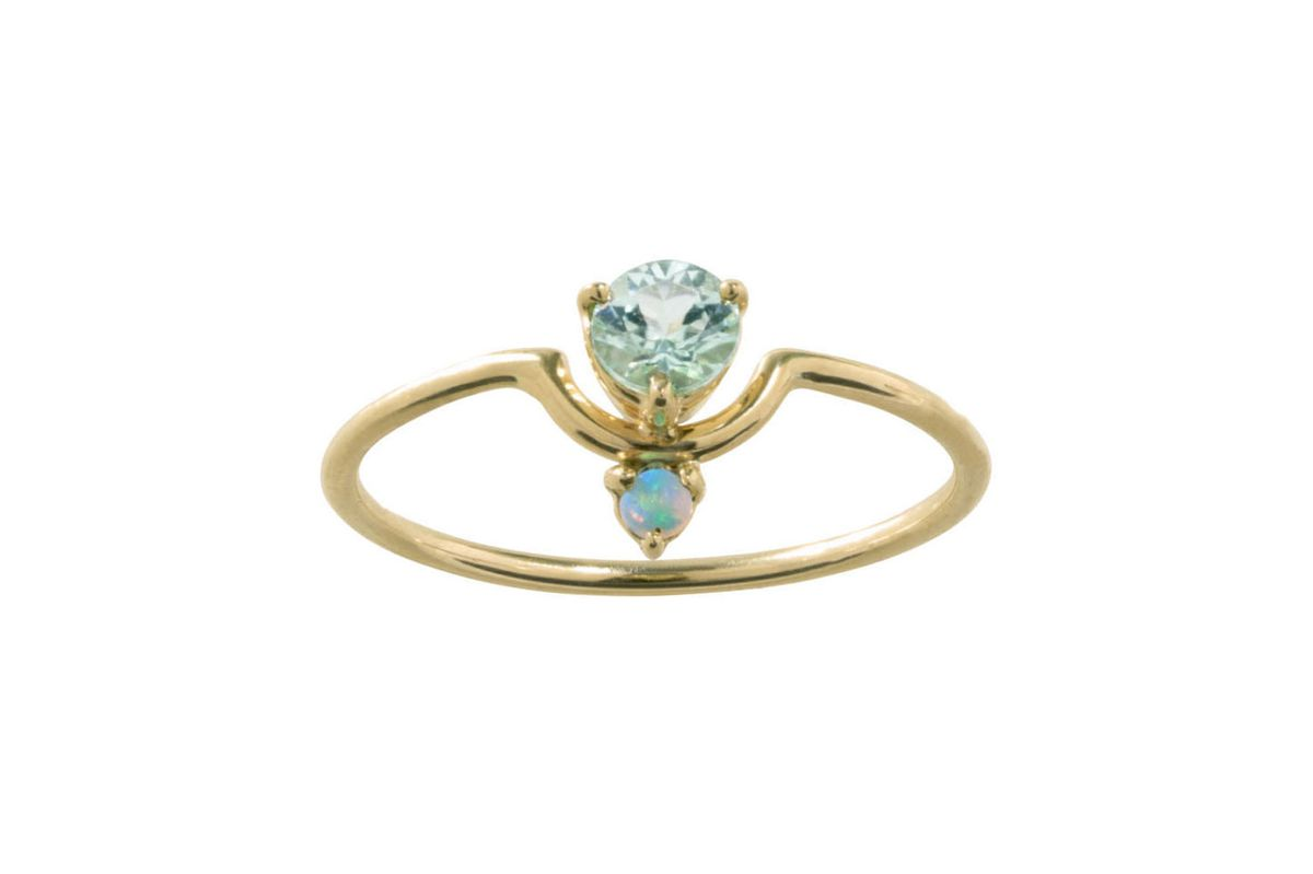 A nestled gem and opal ring