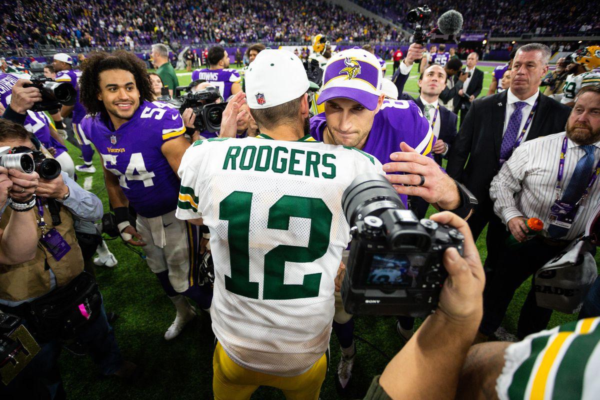Green Bay Packers quarterback Aaron Rodgers and Minnesota Vikings quarterback Kirk Cousins hug after the game at U.S. Bank Stadium.