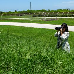 <em>Pauline getting in the weeds to get a pad shot</em>
