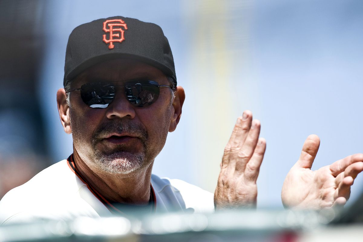 July 25, 2012; San Francisco, CA, USA; San Francisco Giants manager Bruce Bochy (15) encourages his players as they bat in the eighth inning against the San Diego Padres at AT&T Park.  Mandatory Credit: Ed Szczepanski-US PRESSWIRE