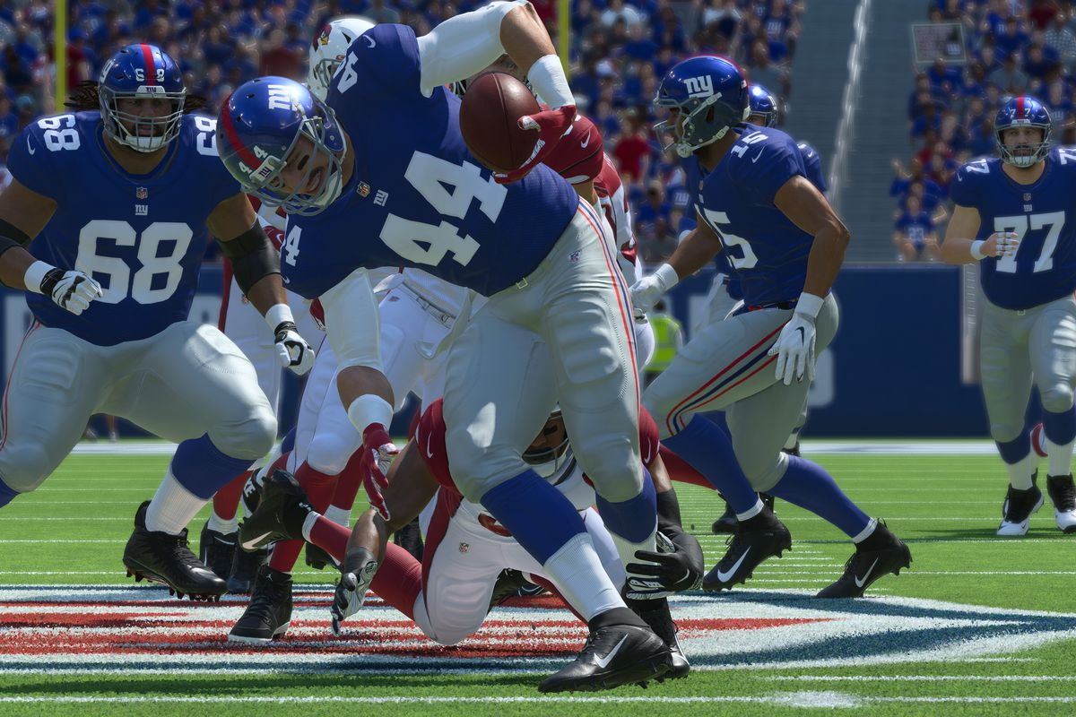 a running back, No. 44, struggles to regain his balance after avoiding a tackle attempt