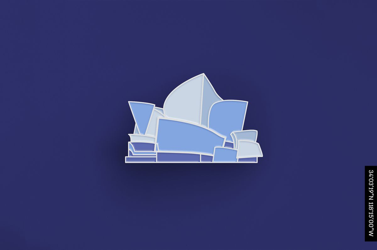 An enamel pin of the Walt Disney Concert Hall, whose facade features a series of large, irregularly shaped steel pieces resembling sails.