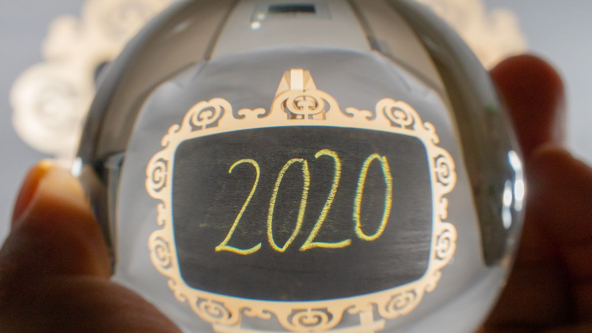 A crystal ball with a reflection of the year 2020