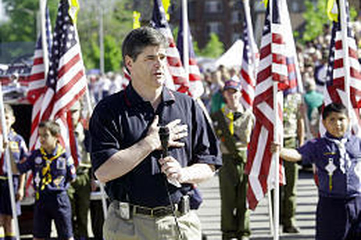 Talk-show host Sean Hannity leads the Pledge of Allegiance at start of parade in Provo on July 4, 2003.