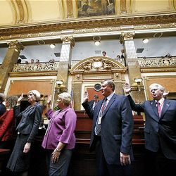 New Members of the Utah House of Representatives take the oath of office at the start of the 2009 session of the Utah Legislature at the Capitol building in Salt Lake City, Monday.
