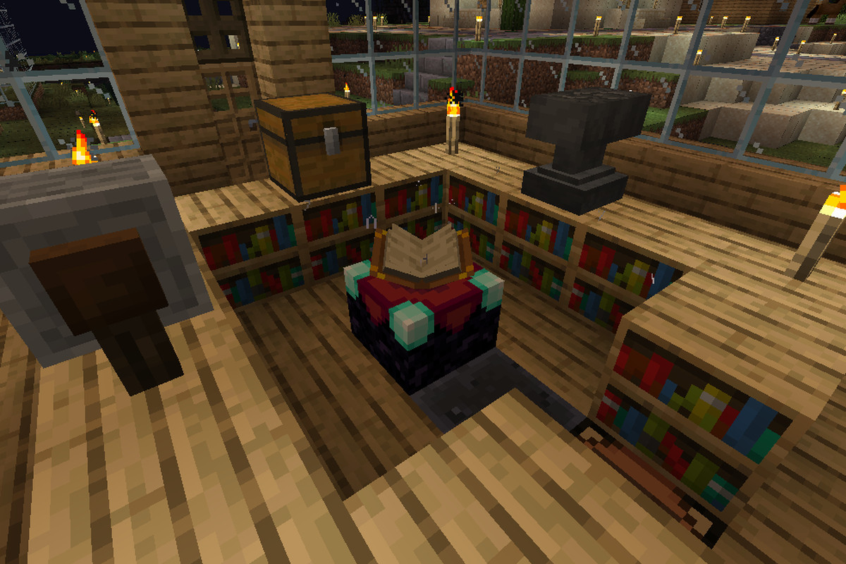 An Enchantment Table surrounded by Bookshelves and other tools in Minecraft
