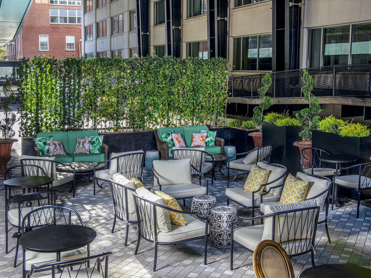 Patio seats at Dauphine's are entirely covered.