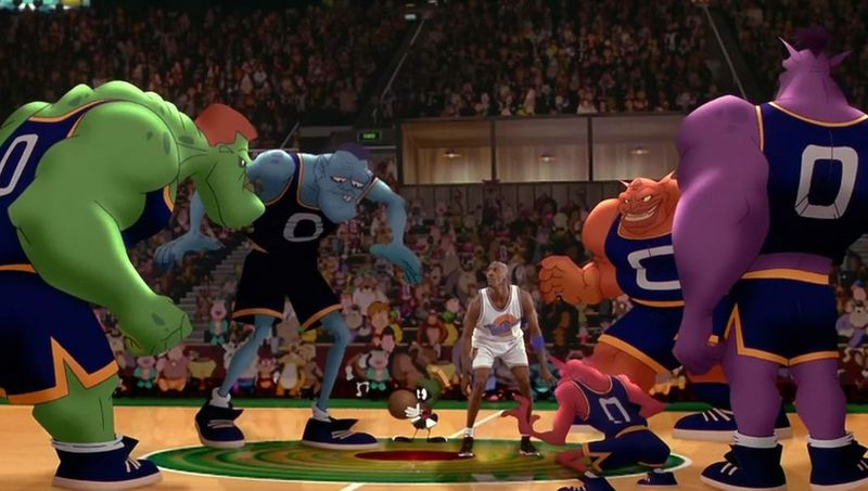 "A still from Space Jam showing Michael Jordan surrounded by the ""Monstars."""