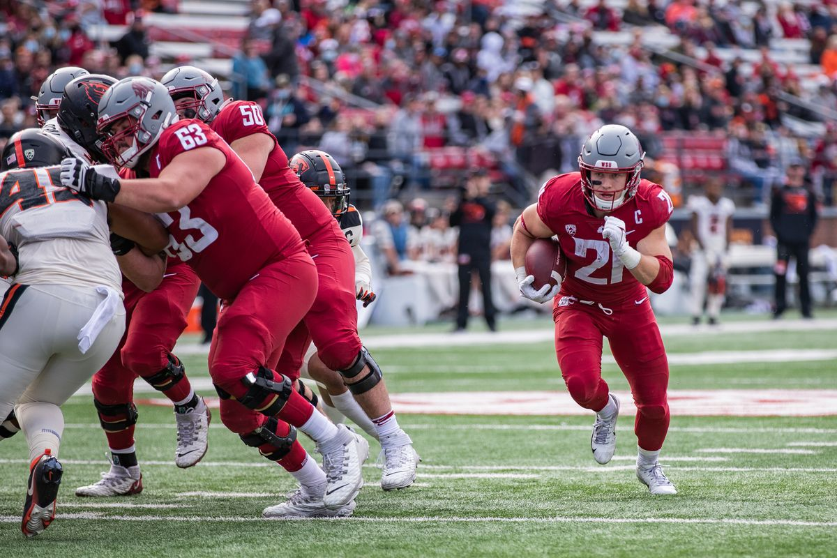 PULLMAN, WA - OCTOBER 9: Washington State running back Max Borghi (21) follows his blockers on a run during the second half of a PAC 12 conference matchup between the Oregon State Beavers and the Washington State Cougars on October 9, 2021, at Martin Stadium in Pullman, WA.