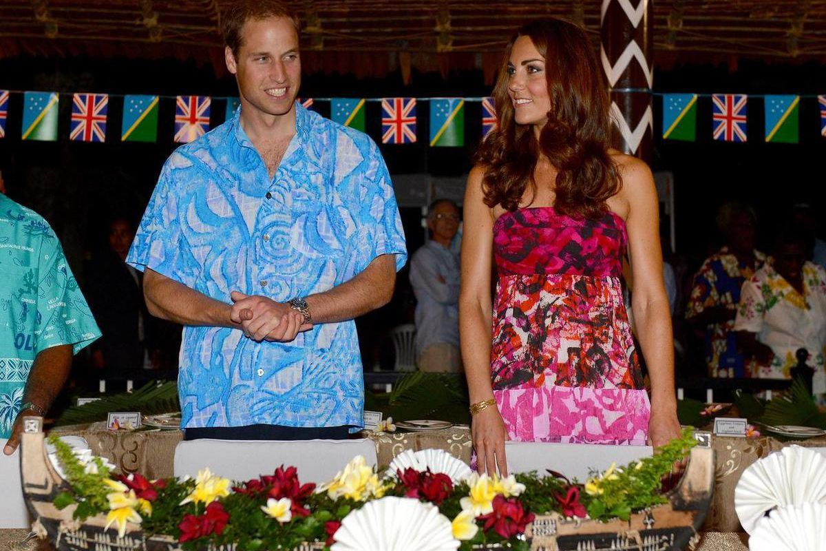 Britain's Prince William, left,  and his wife Kate prepare to sit for a meal at Government House in Honiara, Solomon Islands, Sunday, Sept. 16, 2012.   The royal couple is on a nine-day tour of the Far East and South Pacific in celebration of Queen Elizab