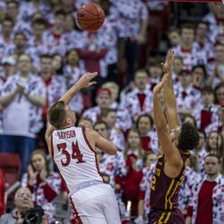 Brad Davison draws the foul in the first half with the left-handed layup.