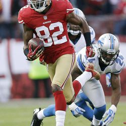 San Francisco 49ers wide receiver Mario Manningham carries the ball past Detroit Lions strong safety Erik Coleman, right, during the first quarter of an NFL football game in San Francisco, Sunday, Sept. 16, 2012.