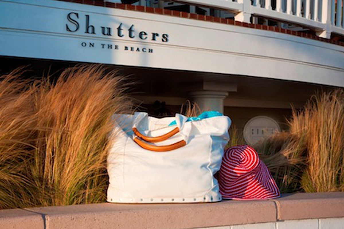 """Oooh, does it come with the hat? Image via <a href=""""http://latimesblogs.latimes.com/alltherage/2010/07/joie-creates-a-limited-edition-beach-bag-for-shutters-on-the-beach.html"""">All the Rage</a>."""
