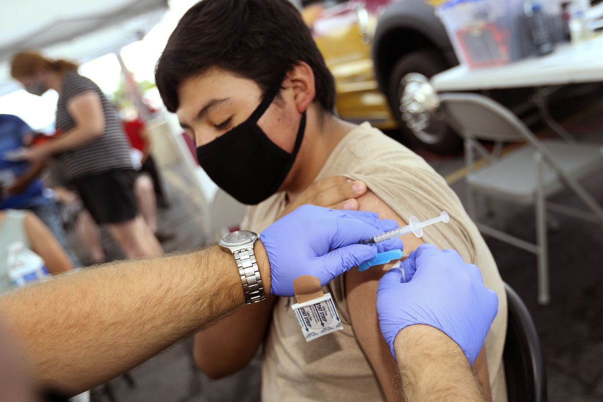 Alan Hernandez, 15, gets a free COVID-19 vaccination at the Salt Lake County Health Department's mobile health center at Rancho Market in West Valley City on Friday, July 30, 2021.