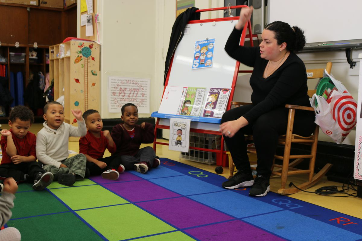 Kristal Torres leads 3-K students in a song at P.S. 277 in the Bronx. Mayor Bill de Blasio has pushed to make pre-K universally available to students starting at 3-years-old.