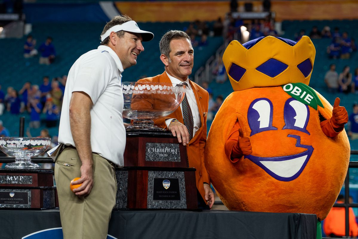 University of Florida Gators Coach Dan Mullen and Obie during the Trophy Ceremony after the 2019 Capital One Orange Bowl college football game between the University of Virginia Cavaliers and the University of Florida Gators on December 30, 2019, at Hard Rock Stadium in Miami Gardens, FL.