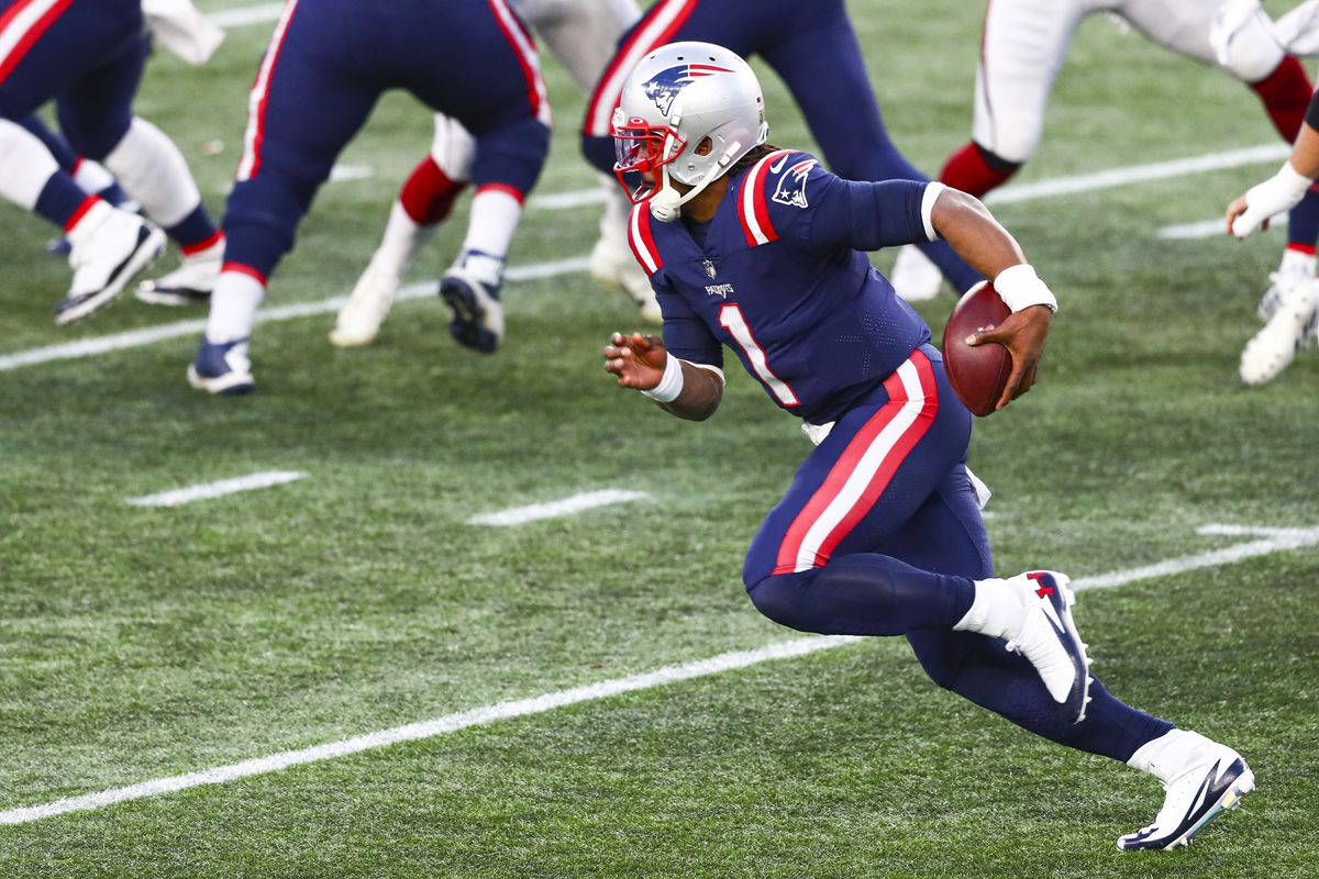Cam Newton #1 of the New England Patriots runs with the ball during a game against the Arizona Cardinals at Gillette Stadium on November 29, 2020 in Foxborough, Massachusetts.