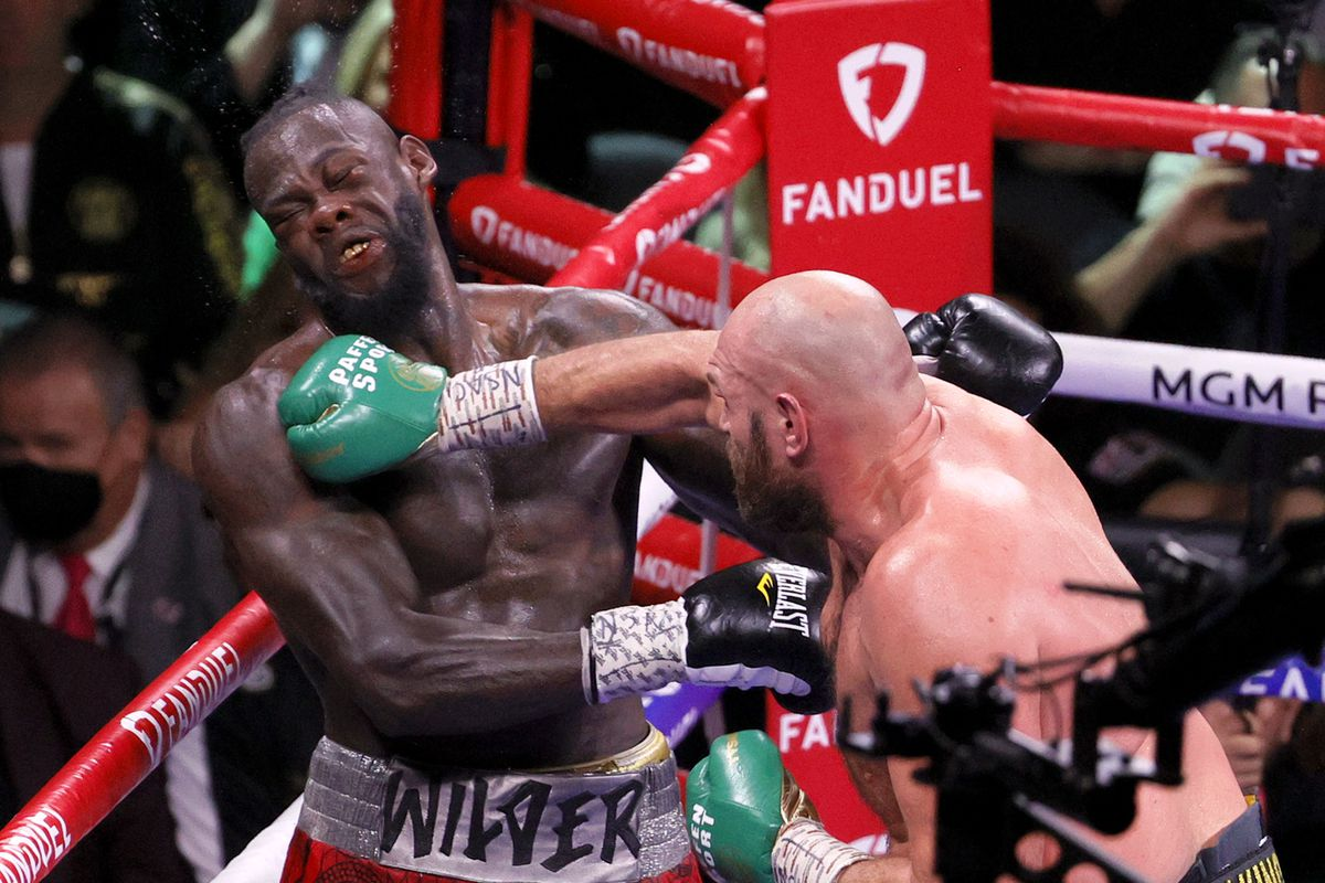 Tyson Fury lands a right hand on Deontay Wilder at the eighth round of their 11-round barnburner on Saturday.