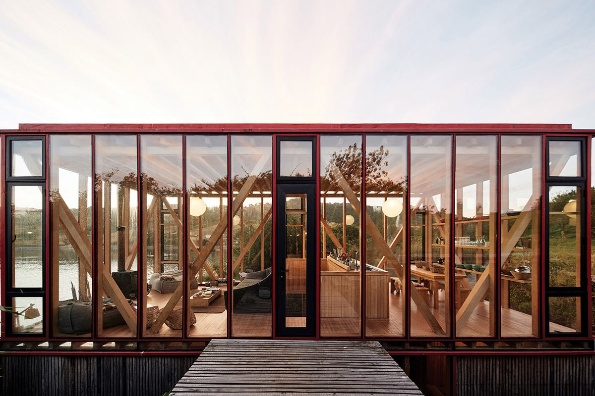 glassy top level of timber seaside home
