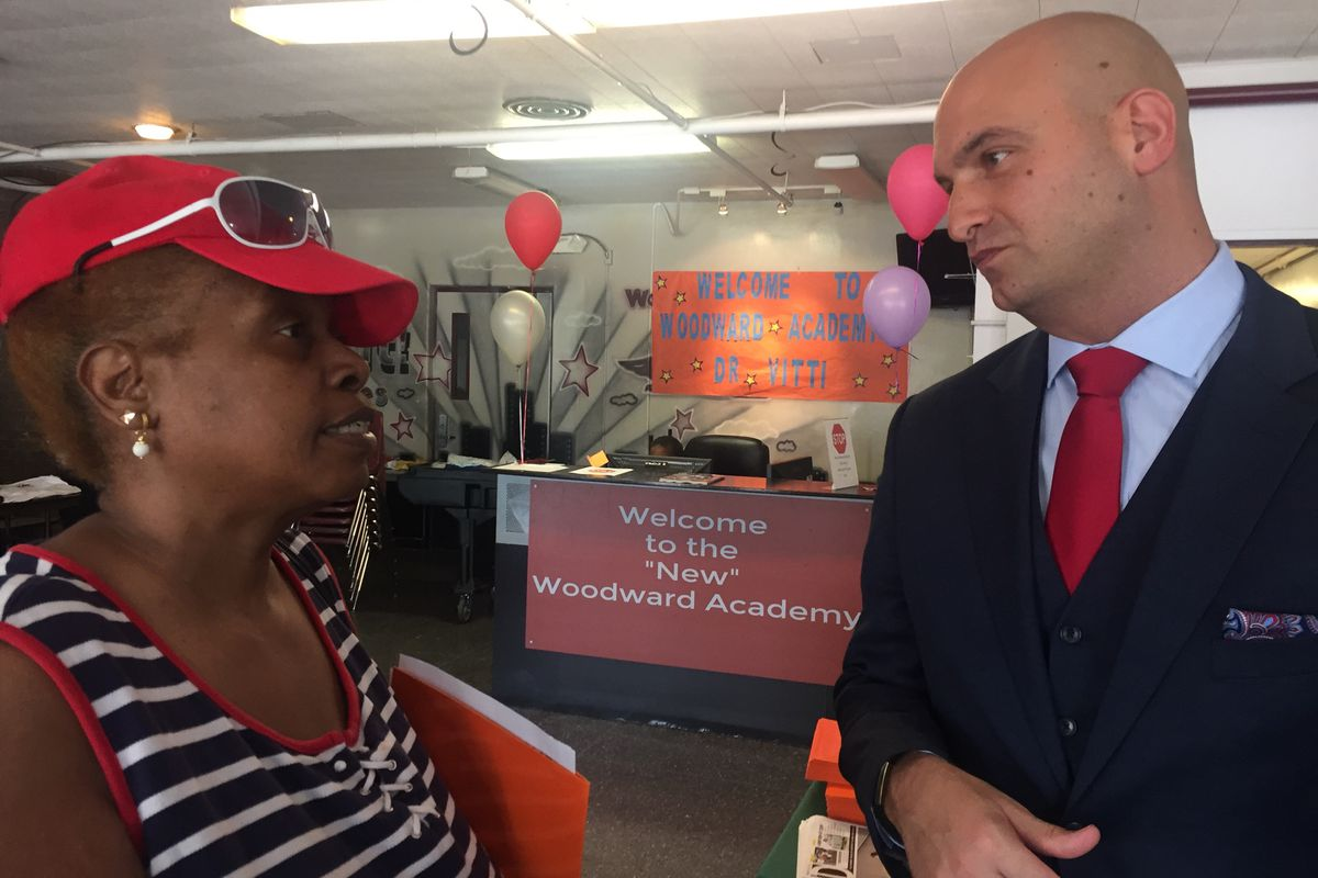 Detroit schools Superintendent Nikolai Vitti speaks with Detroiter Judy Lewis. whose granddaughter Kymora now attends the Woodward Academy.