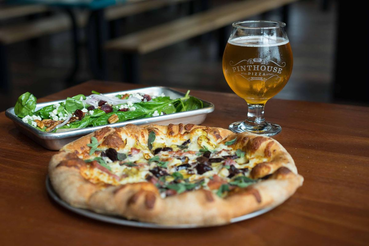A salad, pie, and beer from Pinthouse Pizza