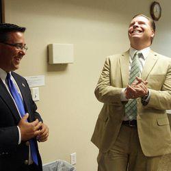 Former state Sen. Dan Liljenquist, right,  laughs with the Rev. Greg Johnson prior to speaking to pastors at the Salt Lake Christian Center in Salt Lake City  Tuesday, June 12, 2012.