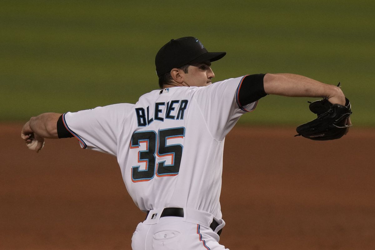 Richard Bleier of the Miami Marlins delivers a pitch with bases loaded during the eighth inning against the Arizona Diamondbacks at loanDepot park