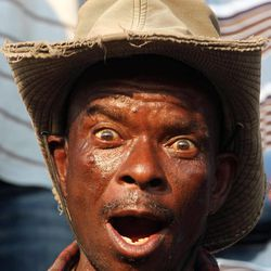 Miner reacts during their gathering in Lonmin Platinum Mine near Rustenburg, South Africa, Tuesday, Sept. 18, 2012. Striking miners have accepted a company offer of a 22% overall pay increase to end more than five weeks of crippling and bloody industrial action.