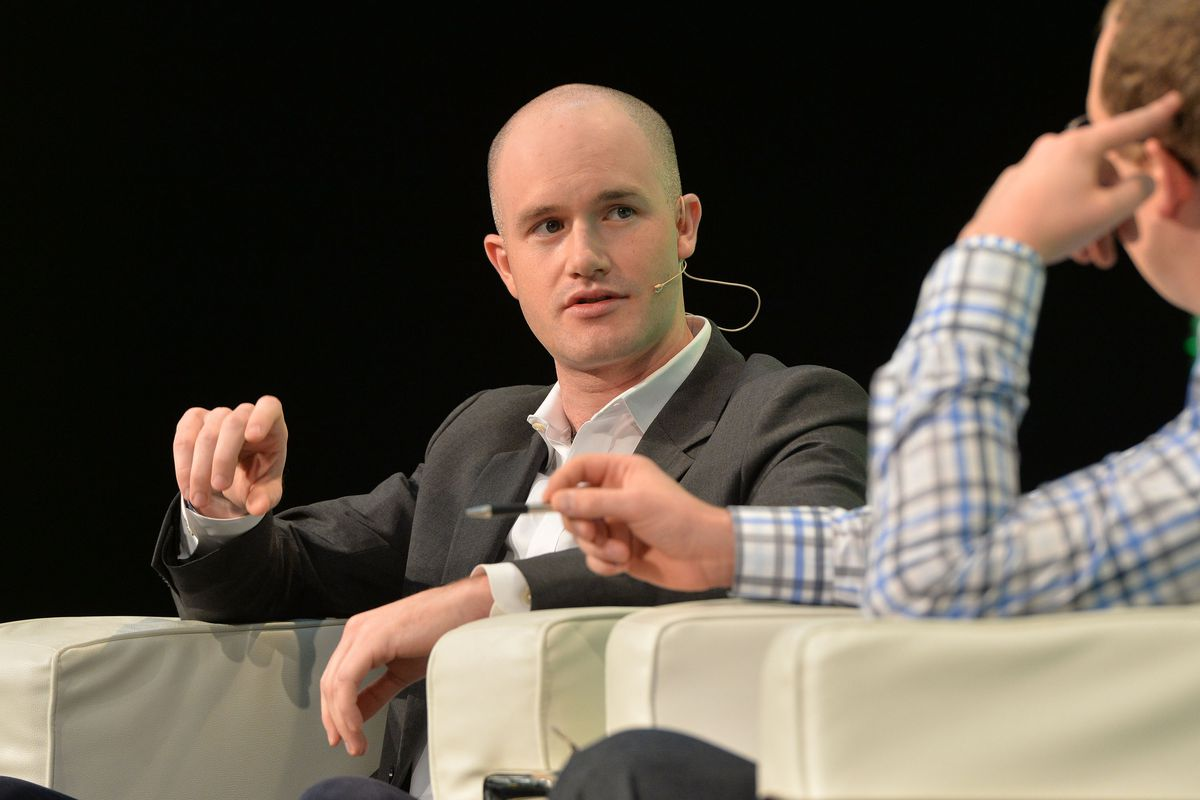 Coinbase CEO Brian Armstrong speaks onstage