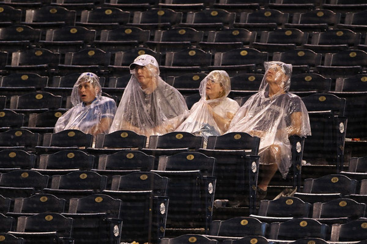 KANSAS CITY MO - AUGUST 13:  Fans wait in the stands during a rain delay in the game between the New York Yankees and the Kansas City Royals on August 13 2010 at Kauffman Stadium in Kansas City Missouri.  (Photo by Jamie Squire/Getty Images)