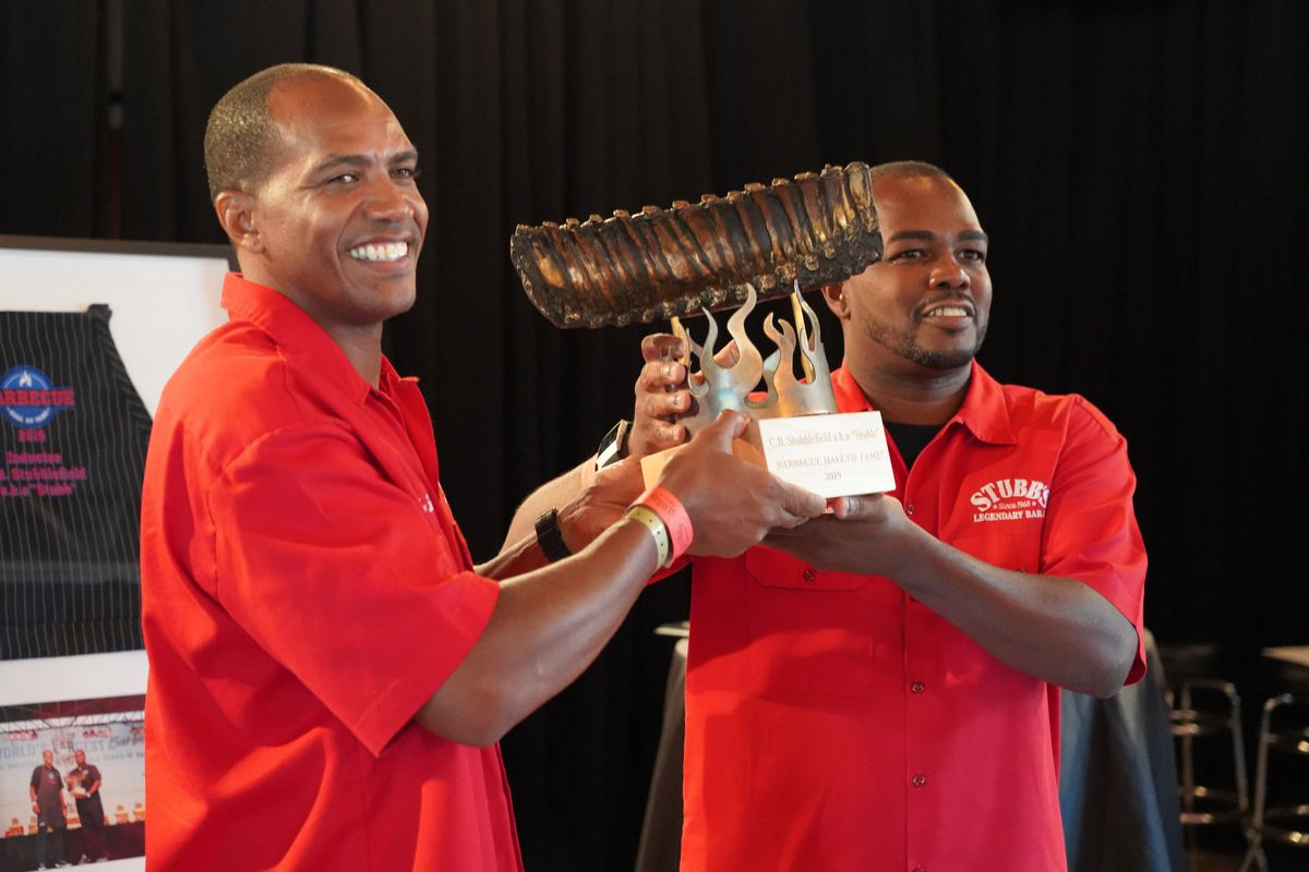 C.B. Stubblefield's grandsons Rocky and Reggie Stubblefield accepting the Barbecue Hall of Fame trophy in Austin