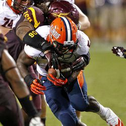 Illinois running back Donovonn Young, front, is tackled by Arizona State defensive tackle Will Sutton (90) during the second half of an NCAA college football game, Saturday, Sept. 8, 2012,in Tempe, Ariz.