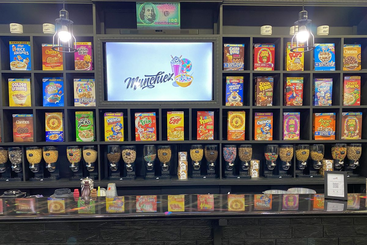 A wall display of cereal boxes.