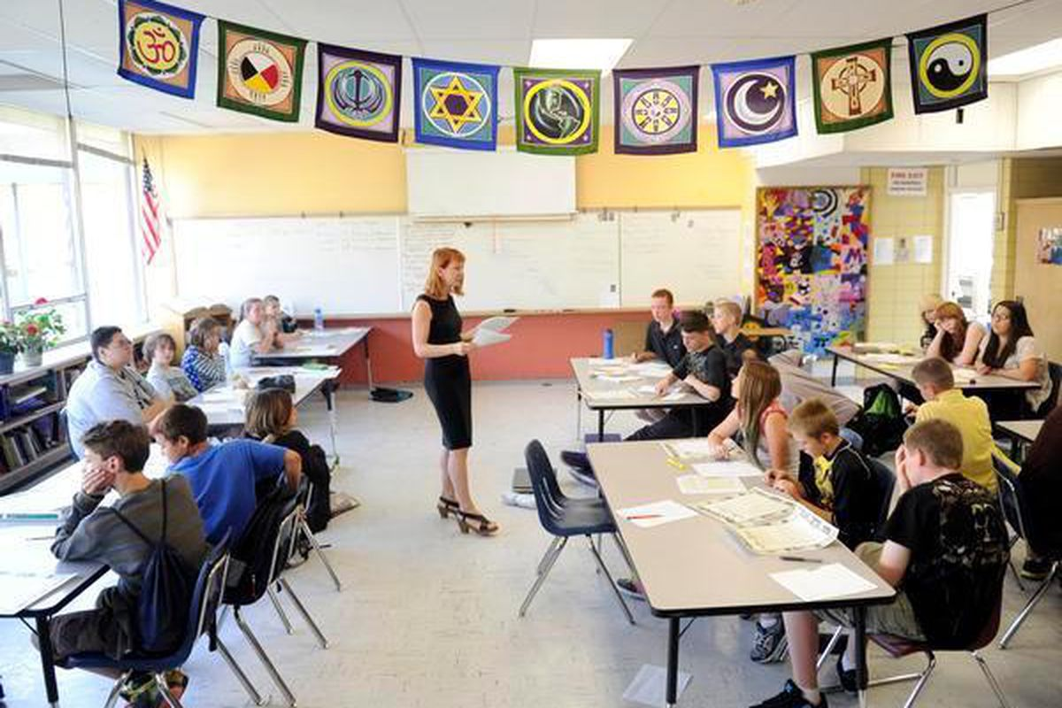 Eve Brady instructs her sixth-, seventh- and eighth-grade humanities students at Englewood Leadership Academy in a classroom at Englewood High School.