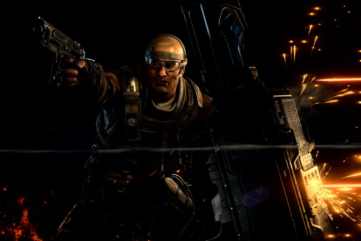 Call of Duty: Black Ops 4 - Ajax holding up a barrier and firing a pistol