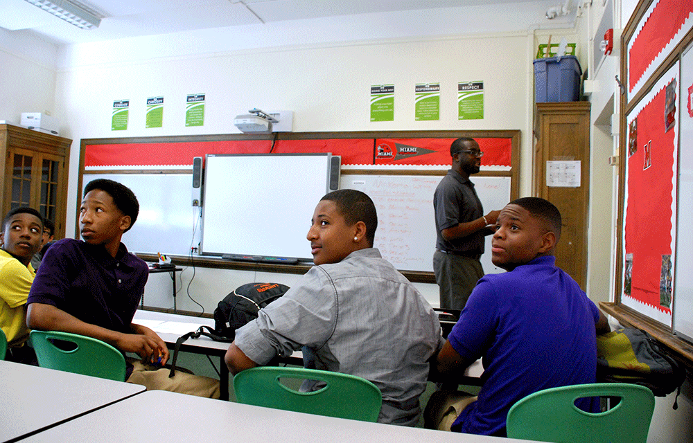 Freshmen at DSST Cole High School in Dexter Korto's morning advisory class look to the back of the class where English standards are posted. Korto, standing, taught at DSST Cole Middle School before following the freshman to open the new high school in northeast Denver.