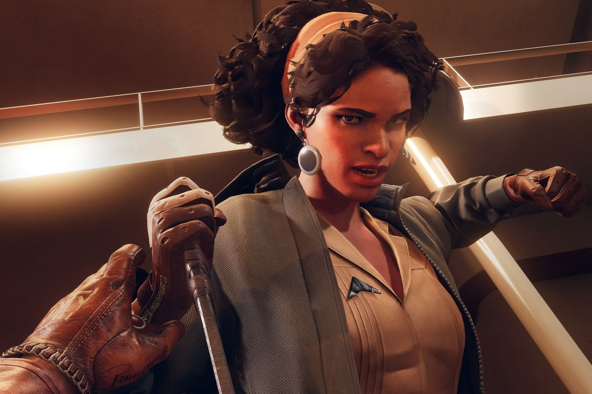 Deathloop - Julianna, the game's rival assassin, throws back a hand to punch Colt