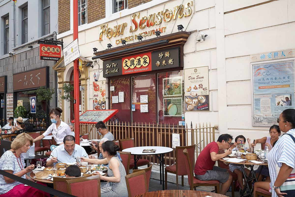 Guests enjoy an Eat Out to Help Out meal at Four Seasons in London's Chinatown last week
