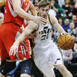 Utah Jazz's small forward Gordon Hayward (20) drives around Houston's Omer Asik as the Jazz and the Rockets play Saturday, Nov. 2, 2013 in EnergySolutions arena.