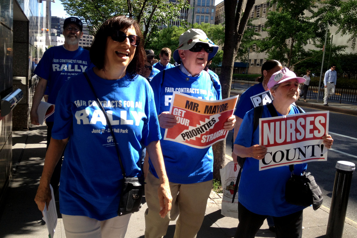 Teachers and other UFT members at a rally in 2013 calling on the city to negotiate a new contract.