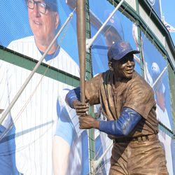 5:28 p.m. The Ernie Banks statue with the Joe Maddon tarp -