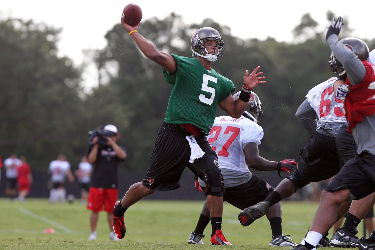 July 28, 2012; Tampa, FL, USA;  Tampa Bay Buccaneers quarterback Josh Freeman (5) throws the ball during training camp at One Buc Place. Mandatory Credit: Kim Klement-US PRESSWIRE
