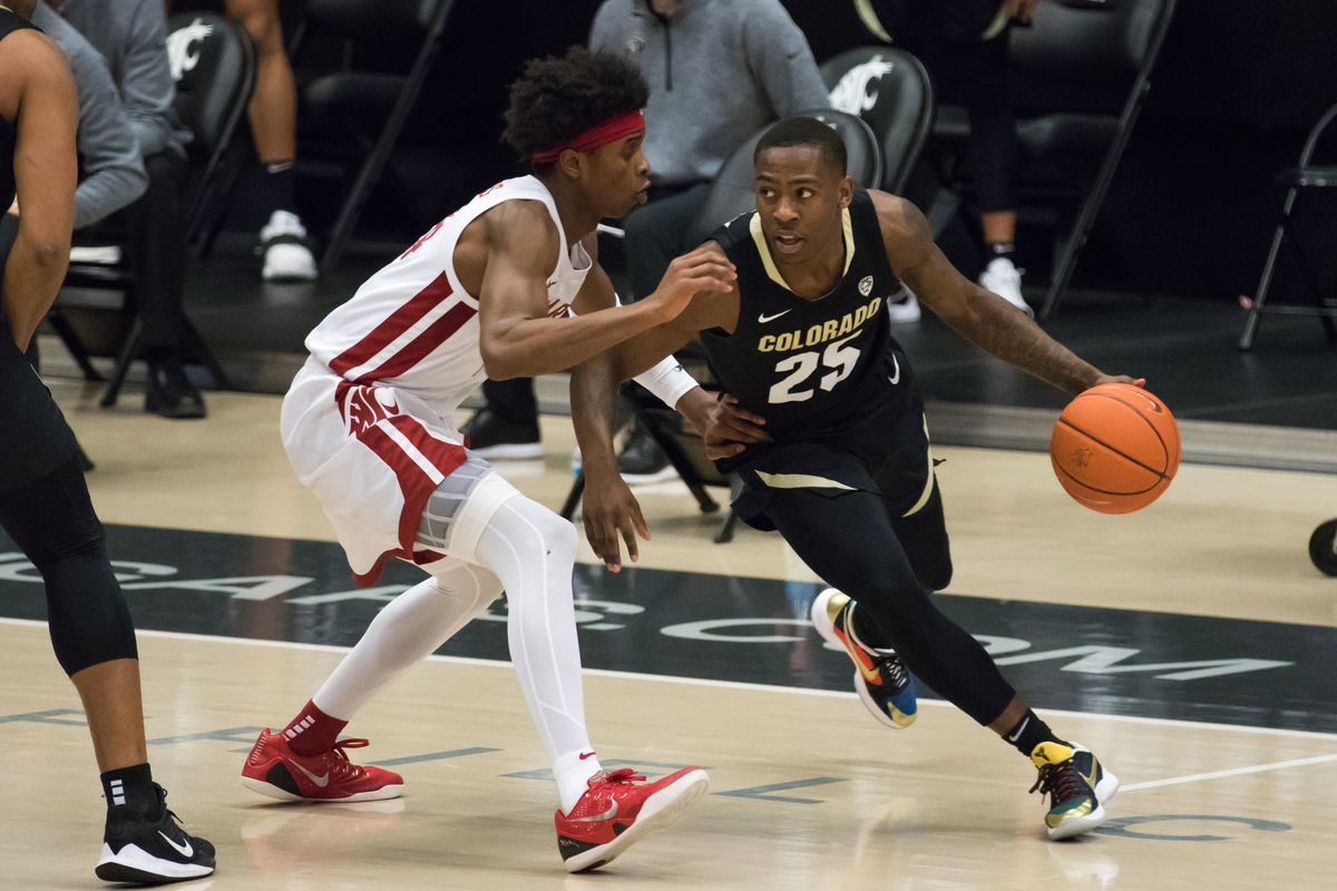 PULLMAN, WA - JANUARY 23: Washington State guard Noah Williams (24) applies pressure on Colorado guard McKinley Wright IV (24) during the second half of a Pac 12 matchup between the Colorado Buffaloes and the Washington State Cougars on January 23, 2021, at Beasley Coliseum in Pullman, WA.