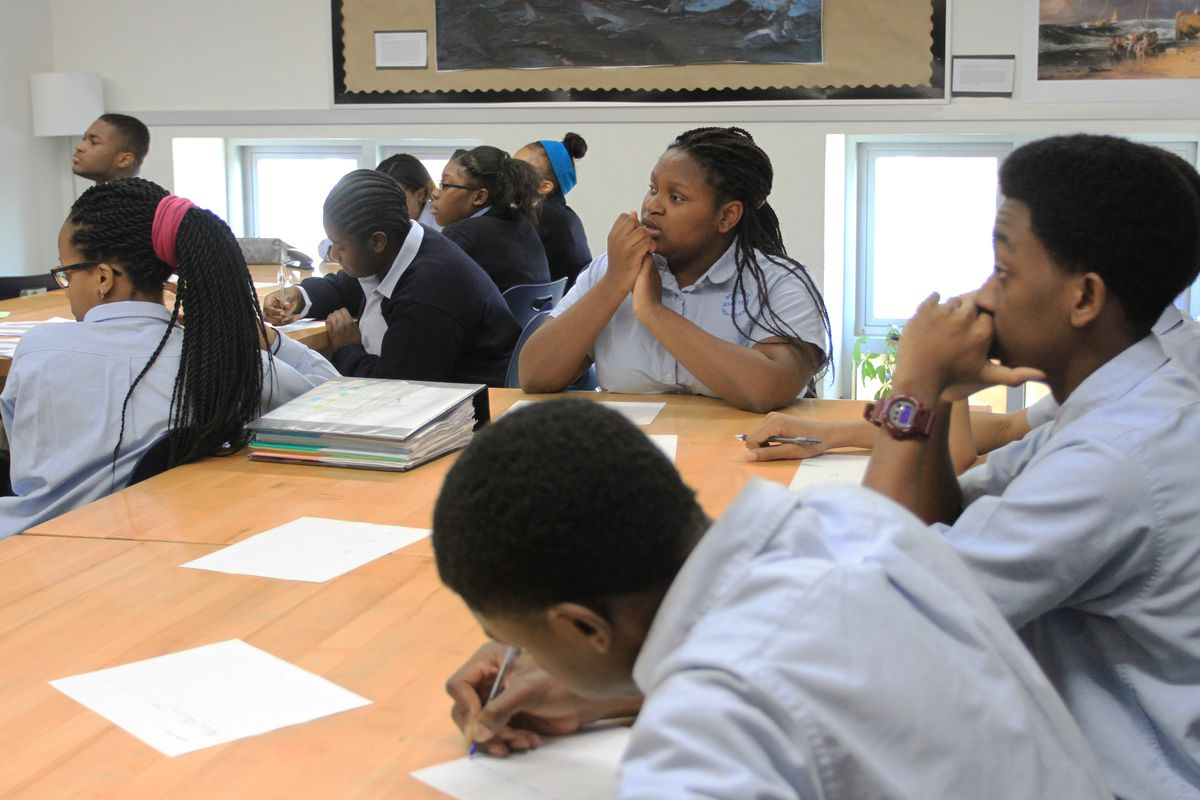 Ninth-grade students listen to their peers present a project in their literature class at Brooklyn Ascend High School.