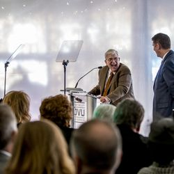 """Ira A. Fulton laughs while speaking prior to the unveiling of the """"Roots of Knowledge"""" in the Fulton Library, named in his honor, on the Utah Valley University campus in Orem on Friday, Nov. 18, 2016, in Orem. UVU President Matthew S. Holland stand to the right."""