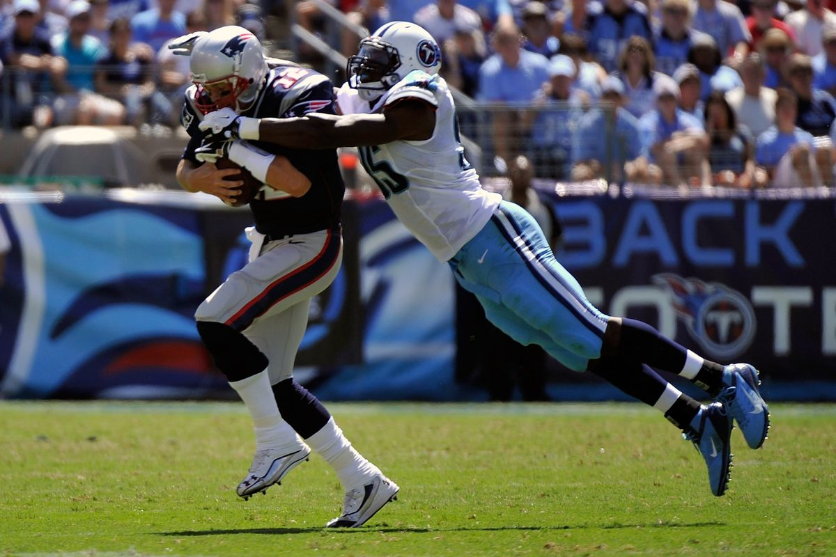 Kamerion Wimbley #95 of the Tennessee Titans sacks Tom Brady #12 of the New England Patriots during their season opener